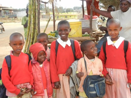 children in red uniforms